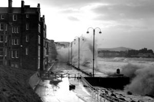 Waves crashing into a street